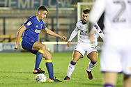 AFC Wimbledon midfielder Anthony Hartigan (26) dribbling during the EFL Trophy match between AFC Wimbledon and Luton Town at the Cherry Red Records Stadium, Kingston, England on 31 October 2017. Photo by Matthew Redman.