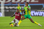 Michail Antonio (30) of West Ham United tussles with Semi Ajayi (6) of West Bromwich Albion during the Premier League match between West Ham United and West Bromwich Albion at the London Stadium, London, England on 19 January 2021.