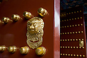 Nails and lion-head door knocker on gate to the Tower of Buddhist Incense at The Summer Palace, Beijing, China
