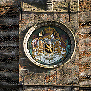 A royal seal on the front of the Belfry (bell tower) in the Markt (Market Square) in the historic center of Bruges, a UNESCO World Heritage site.
