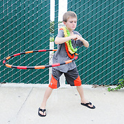 Hudson Kantrowitz, 7, hula hoops Thursday August 7, 2014 during The Shrip-A-Roo at Buddy's Crab House & Oyster Bar in Wrightsville Beach, N.C.  (Jason A. Frizzelle)