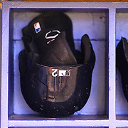 The batting helmet and batting glove of New York Yankees shortstop Derek Jeter (2) is seen in the dugout during a major league baseball game between the New York Yankees and the Tampa Bay Rays at Tropicana Field on Thursday, Sept. 17, 2014 in St. Petersburg, Florida. The Yankees won the game 3-2 and this was Jeter's last game against Tampa Bay. (AP Photo/Alex Menendez)