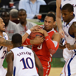 Mar 31, 2012; New Orleans, LA, USA; Kansas Jayhawks guard Travis Releford (24) attempts to steal the ball from Ohio State Buckeyes forward Jared Sullinger (0) as guard Tyshawn Taylor (10) and forward Thomas Robinson (far right) defend during the second half in the semifinals of the 2012 NCAA men's basketball Final Four at the Mercedes-Benz Superdome. Mandatory Credit: Derick E. Hingle-USA TODAY SPORTS