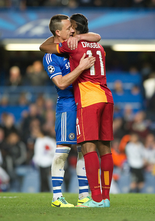 Chelsea's John Terry embraces Galatasaray's Didier Drogba at the end of the game<br /> <br /> Photo by Ashley Western/CameraSport<br /> <br /> Football - UEFA Champions League First Knockout Round 2nd Leg - Chelsea v Galatasaray - Tuesday 18th March 2014 - Stamford Bridge - London<br />  <br /> © CameraSport - 43 Linden Ave. Countesthorpe. Leicester. England. LE8 5PG - Tel: +44 (0) 116 277 4147 - admin@camerasport.com - www.camerasport.com