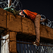 An Afghan migrant who was recently denied asylum in Greece after fleeing his home sneaks back into a refugee camp outside of Athens. He was one of a few migrants who were transferred from Moria camp, a settlement on the Greek island of Lesbos made for 2,500 but holds nearly three times that amount. Now considered illegal in Greece, he is considering migrating up north but for now, must deal with sneaking into a refugee camp at night for shelter.