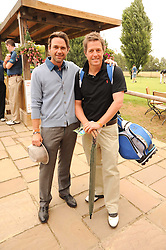 Left to right, DOUGRAY SCOTT and HUGH GRANT at the Mini Masters Golf tournament in aid of LEUKA - London's celebrity golf tournament was held at Duke's Meadow Golf Club, Dan Mason Drive, London W4 on 16th July 2010.