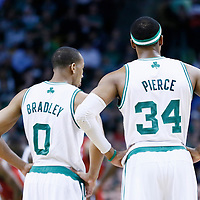 18 March 2013: Boston Celtics point guard Avery Bradley (0) and Boston Celtics small forward Paul Pierce (34) rest during the Miami Heat 105-103 victory over the Boston Celtics at the TD Garden, Boston, Massachusetts, USA.