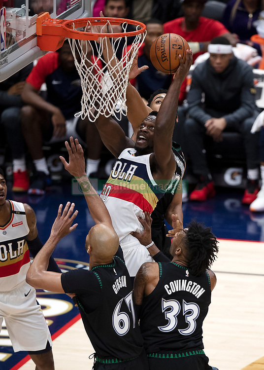 December 31, 2018 - New Orleans, LA, U.S. - NEW ORLEANS, LA - DECEMBER 31:   New Orleans Pelicans forward Julius Randle (30) ducks the ball against Minnesota Timberwolves forward Robert Covington (33) at New Orleans Arena in New Orleans, LA on Oct 23, 2018.  (Photo by Stephen Lew/Icon Sportswire) (Credit Image: © Stephen Lew/Icon SMI via ZUMA Press)