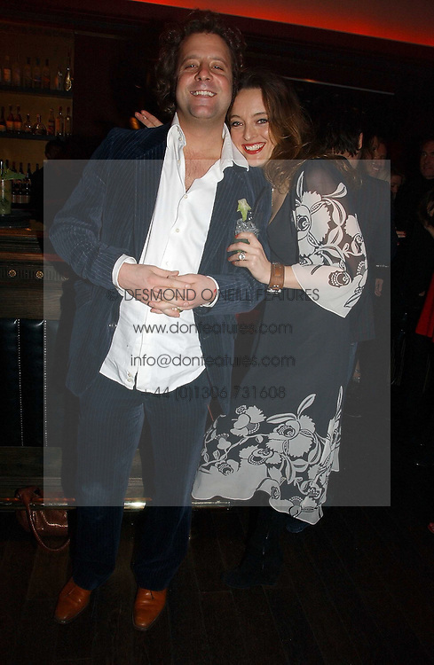 Designer ALICE TEMPERLEY and her husband LARS VON BENNIGSEN at a party hosted by Camilla Al Fayed, Charlotte Stockdale and Patrick Cox in aid of the Evelina Children's Hospital Trust held at th Burlington Club, New Burlington Street, London on 12th December 2006.<br /><br />NON EXCLUSIVE - WORLD RIGHTS