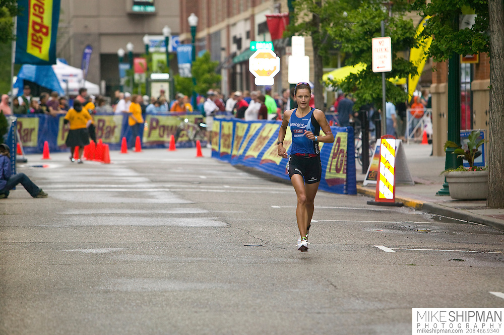 Idaho, Ada County, Boise, Boise 70.3 Ironman, Linsey Corbin from Missoula, MT, runs on 8th street, she finished second behind Magali Tisseyre with a time of 4:20:58