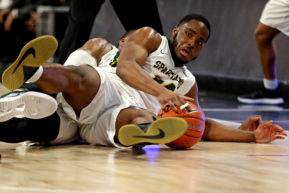 Mar 16, 2019; Norfolk, VA, USA; Norfolk State Spartans guard Steven Whitley (34) slides out of bounds with the ball during the second half against the North Carolina Central Eagles in the MEAC Tournament Final at The Scope. Mandatory Credit: Peter Casey-USA TODAY Sports