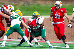 NORMAL, IL - October 05: Tony Pierce wraps up James Robinson during a college football game between the ISU (Illinois State University) Redbirds and the North Dakota State Bison on October 05 2019 at Hancock Stadium in Normal, IL. (Photo by Alan Look)