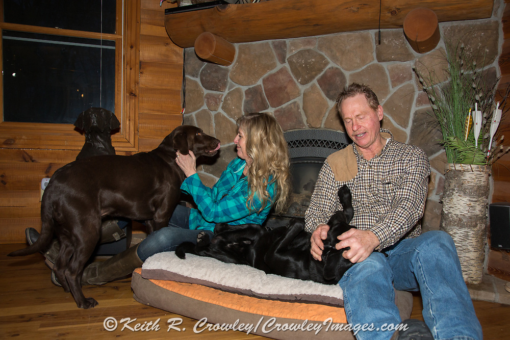 Renowned dog trainers Tom and Tina Dokken relax at home with their owns dogs, Sassy and Chase.