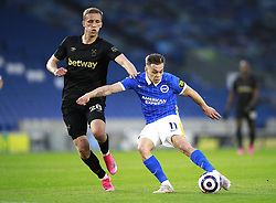 West Ham United's Tomas Soucek (left) and Brighton and Hove Albion's Leandro Trossard battle for the ball during the Premier League match at the American Express Community Stadium, Brighton. Picture date: Saturday May 15, 2021.