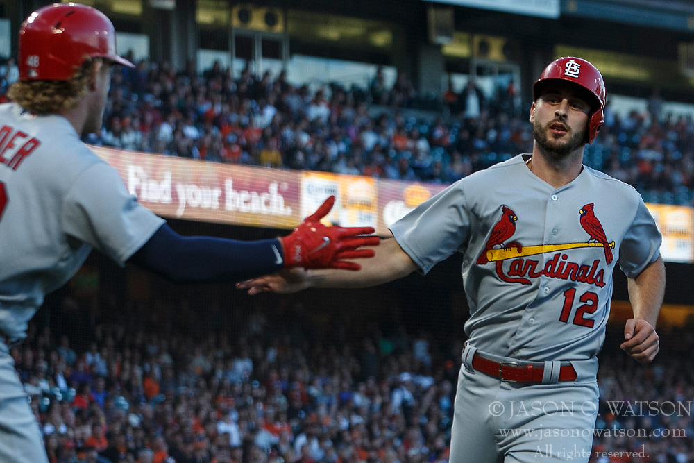 SAN FRANCISCO, CA - JULY 06: Paul DeJong #12 of the St. Louis Cardinals is congratulated by Harrison Bader #48 after scoring a run against the San Francisco Giants during the second inning at AT&T Park on July 6, 2018 in San Francisco, California. The San Francisco Giants defeated the St. Louis Cardinals 3-2. (Photo by Jason O. Watson/Getty Images) *** Local Caption *** Paul DeJong; Harrison Bader