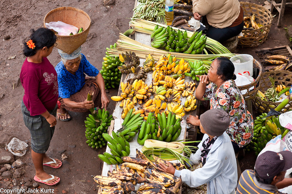 25 APRIL 2010 - PAYANGAN, BALI, INDONESIA: Bananas and plantains for sale in the market in Payangan, Bali. Many Indonesians shop every day because they don't have refrigerators in their homes.  PHOTO BY JACK KURTZ
