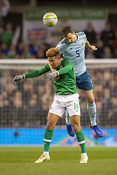 November 15, 2018 - Dublin, Ireland - Callum Robinson of Ireland jumps for the ball with Jonny Evans of N.Ireland during the International Friendly match between Republic of Ireland and Northern Ireland at Aviva Stadium in Dublin, Ireland on November 15, 2018  (Credit Image: © Andrew Surma/NurPhoto via ZUMA Press)