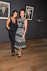 Left to right, DEBBI CLARK and HELEN McCRORY at a private view of photographs in aid of the Sir Hubert von Herkomer Arts Foundation held at Alon Fine Art, 5-7 Dover Street, London on 8th September 2015.