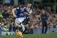Séamus Coleman (Everton) is fouled by Ayoze Perez (Newcastle United) as Roberto Martínez (Everton) watches on during the Barclays Premier League match between Everton and Newcastle United at Goodison Park, Liverpool, England on 3 February 2016. Photo by Mark P Doherty.