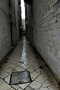 Narrow paved alley of Dubrovnik old town after light rain, Dubrovnik old town, Croatia