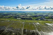 Nederland, Friesland, Gemeente Ferwerderadeel, 28-02-2016; Friesche Wad met kweldergebied en buitendijkse polder van Noorderleeg (Noarderleech) ook Noard-Fryslan Butendyks ter hoogte van Ferwerd (Ferwert). De landinwaarts gelegen polders zijn in het verleden ontstaan door bedijking van de kwelders.<br /> In de voorgrond landaanwinning door middel van zogenaamde kwelderwerken: vakken begrenst door rijshouten golfbrekers die als gevolg hebben dat het slib kan bezinken. Als de kwelders hoog genoeg groeien er er kwelderplanten.<br /> Land reclamation, Noorderleeg (Northern Void), polder and salt marsh area outside the dikes. The so-called salt marsh works consist of square sections, bordered by brushwood breakwaters causing the sludge to settle.<br /> The inland polders have been created by building dams in the salt marshes in the past.<br /> luchtfoto (toeslag op standard tarieven);<br /> aerial photo (additional fee required);<br /> copyright foto/photo Siebe Swart