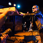 WASHINGTON, DC - March 21st, 2014 - Macaulay Culkin of the Pizza Underground hands out pizza to fans at their performance at the Black Cat in Washington, D.C. (Photo by Kyle Gustafson / For The Washington Post)