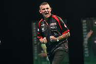 Nathan Aspinall hits a double and celebrates during the Unibet Premier League Play-Offs at the Ricoh Arena, Coventry, England on 15 October 2020.