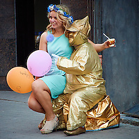 """""""Come Sit on My Lap Little Girl"""" said the Man in Gold. Street Performer in Riga, Latvia. Image taken with a Nikon 1 V2 camera and 10-100 mm VR lens (ISO 400, 94.2 mm, f/5.6, 1/200 sec). Semester at Sea Spring 2013 Enrichment Voyage."""