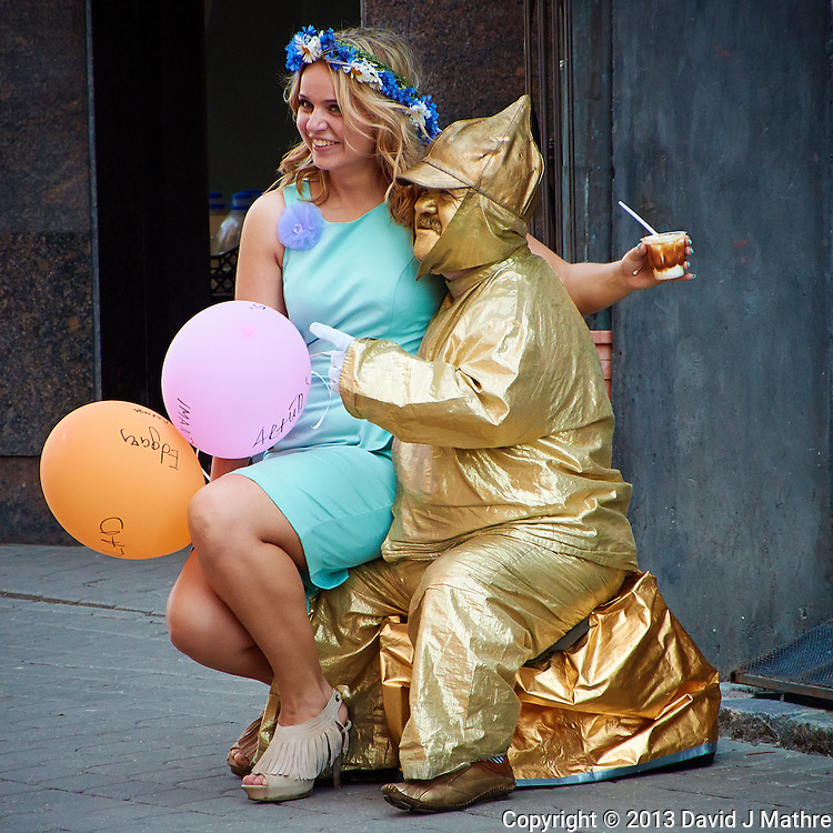 """Come Sit on My Lap Little Girl"" said the Man in Gold. Street Performer in Riga, Latvia. Image taken with a Nikon 1 V2 camera and 10-100 mm VR lens (ISO 400, 94.2 mm, f/5.6, 1/200 sec). Semester at Sea Spring 2013 Enrichment Voyage."