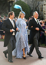 Poppy Delevingne (centre) and Charles Delevingne (right) arrive ahead of the wedding of Princess Eugenie to Jack Brooksbank at St George's Chapel in Windsor Castle.