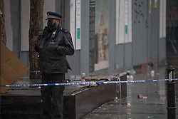 © Licensed to London News Pictures. 08/05/2021. London, UK. Police guard a crime scene after a man in his 30s has been murdered in Dalston, east London. Police were called at 00:56am to reports of shots fired in Gillett Square. Officers found a serously injured man but despite the best efforts of emergency services the man was pronounced dead at the scene. Photo credit: Marcin Nowak/LNP