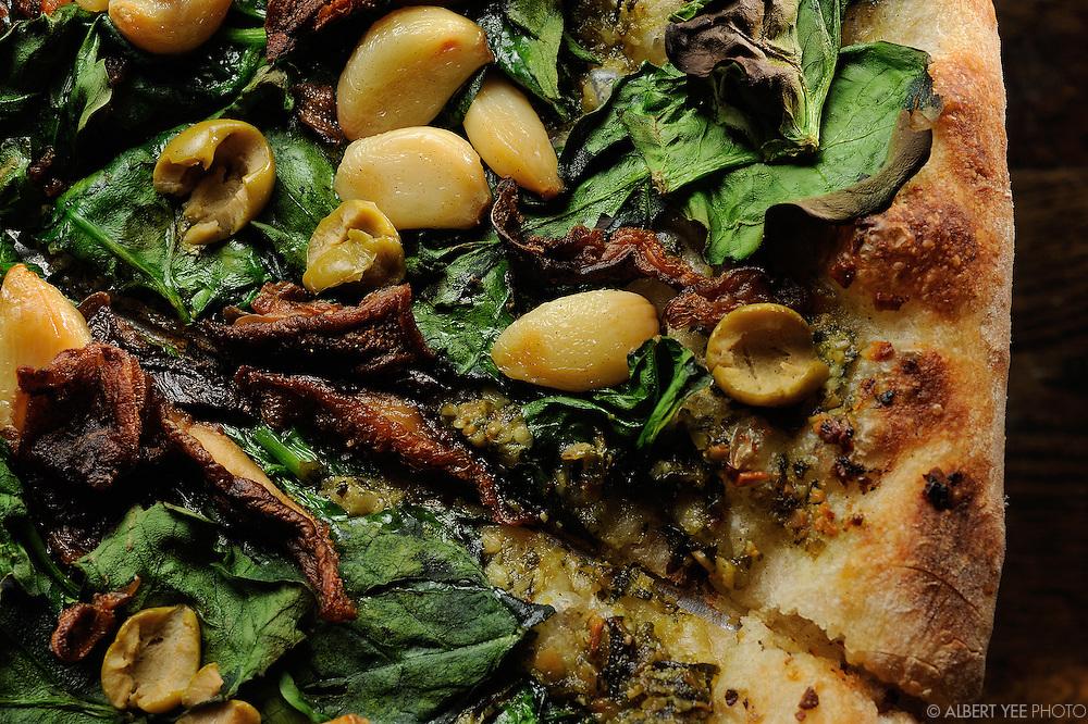 Popeye: wilted spinach, olive oil, green olives, roasted garlic, crispty shiitake mushrooms, pumpkin seed pesto<br /> <br /> Blackbird Pizzeria<br /> <br /> for Grid Magazine<br /> <br /> Feburary 21, 2014