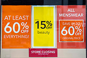 Sale signs outside the Folkestone Debenhams store in the final few days of the 'Everything Must Go' sale before closing down on 13th Jauary 2020 in Folkestone, Kent. United Kingdom. The company announced the closure of 19 stores across the UK after going into administration in 2019.