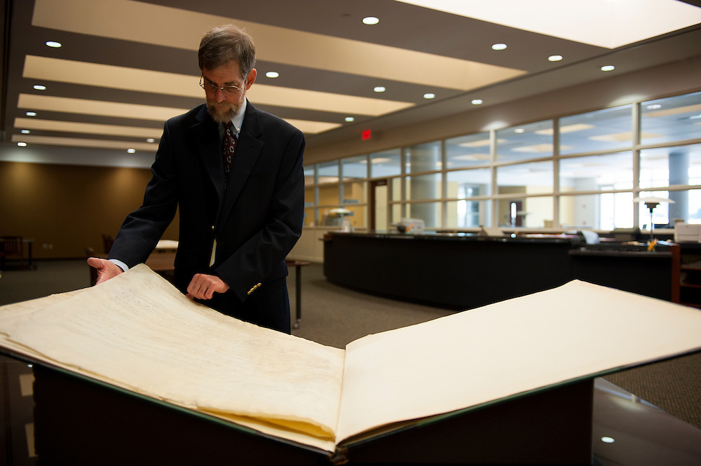 Steven Engerrand, assistant director at the Georgia Archives, examines a copy of the Constitution of the State of Georgia, dated 1798.