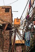 Illegal electricity connections in a street in the Govindpuri slum, New Delhi, India