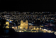 Plaza de Armas, the central square of Cuzco (Cusco or Qosqo), glows at night in Peru, South America. Cuzco was the site of the historic capital of the Inca Empire from the 1200s to 1532 and was honored on the World Heritage List in 1983 by UNESCO. Francisco Pizarro officially founded Spanish Cuzco in 1534. Cuzco is the longest continuously occupied city in the Americas and is built upon the foundations of the Incas (at 3400 meters or 11,200 feet elevation).