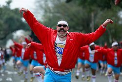 15 Feb 2015. New Orleans, Louisiana.<br /> Mardi Gras. Raunchy in Red. The 610 Stompers dance ahead of The Krewe of Thoth.<br /> Photo; Charlie Varley/varleypix.com