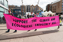 "© Licensed to London News Pictures;31/08/2020; Bristol, UK. Extinction Rebellion protest through Bristol's city centre urging local MPs to support the upcoming Climate and Ecological Emergency Bill. The protest is part of a bank holiday weekend of protest action titled ""Bristol Rebellion: We Want To Live"". XR are protesting in Bristol and other cities in the UK against climate change, leading up to a protest in London starting on 01 September. XR say that despite clear scientific evidence of the deadly climate and ecological emergency, the UK government are refusing to take the urgent action needed to avoid mass extinction. XR say we need politicians to support the Climate and Ecological Emergency Bill. During the coronavirus covid-19 pandemic, climate change is being forgotten but it is still an emergency that is happening, the elephant in the room. Photo credit: Simon Chapman/LNP."