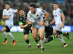 Saracens Brad Barritt is tackled during the Champions Cup match at Franklin's Gardens, Northampton.