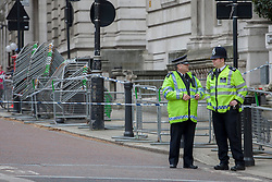 © licensed to London News Pictures. London, UK 19/04/2013. Police officers close Birdcage Walk in Westminster to assist lorries carrying fencing to London Marathon's finish line ahead of the race on Sunday, 21 April, 2013. The number of police officers on duty for the London Marathon has been increased by 40% to provide reassurance after the atrocities in Boston, Scotland Yard has said. Photo credit: Tolga Akmen/LNP