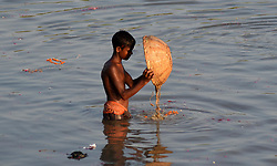 September 4, 2017 - Allahabad, Uttar Pradesh, India - Allahabad: An Indian youth searches for valuable things from pond after devotee immerse Elephant headed Hindu God Ganesha's idol to immerse that pond on the ocassion of Anant Chaturdasi festival celebration in Allahabad on 09-04-2017. (Credit Image: © Prabhat Kumar Verma via ZUMA Wire)