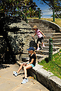 Two children (10 years old, 6 years old) on carved steps near Mrs Macquarie's Chair. The Domain, Sydney, Australia