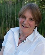 Lynda Tuckerman seated in her garden at Hindringham Hall, Hindringham, Norfolk, UK