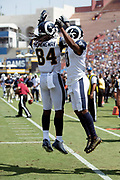 Los Angeles Rams wide receiver Pharoh Cooper (10) leaps and celebrates with a hip bump by Los Angeles Rams tight end Temarrick Hemingway (84) after Brown catches a 6 yard touchdown pass that ties the first quarter score at 7-7 during the 2018 NFL preseason week 3 football game against the Houston Texans on Saturday, Aug. 25, 2018 in Los Angeles. The Rams won the game 21-20. (©Paul Anthony Spinelli)