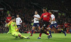 Bournemouth goalkeeper Asmir Begovic blocks a shot from Manchester United's Marcus Rashford during the Premier League match at Old Trafford, Manchester.