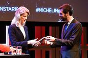 Presentatie van de Michelin Gids 2019 in het DeLaMar Theater. De gids geldt als de meest gezaghebbende culinaire gids.<br /> <br /> Op de foto:  Mona Keijzer, staatssecretaris van Economische Zaken en Klimaat krijgt het eerste exemplaar van Gwendal Poullennec Director of the MICHELIN Guides