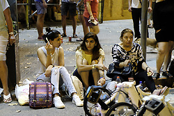 August 18, 2017 - unknown - Barcelona, Spain, August 17, 2017, late afternoon : view of tourists awaiting at the corner of carrer Balmes after the shutting of the neighborhood by the police for a white van running over tourist pedestrians walking down the Rambla in the same style of the Nice or London terrorist attack in 2016 and 2017. Photo credit : Marc Javierre-Kohan / Aurimages (Credit Image: © Marc Javierre Kohan/Aurimages via ZUMA Press)