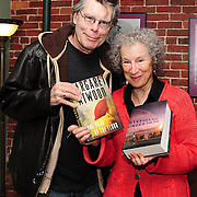 Stephen King and Margaret Atwood exchange signed books backstage before Atwood's appearance on Writers on a New England Stage at The Music Hall, Portsmouth, NH. Sep. 2010.