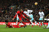Joel Matip of Liverpool heads the ball goalwards but is denied a goal as it hits the crossbar. Premier League match, Liverpool v West Ham Utd at the Anfield stadium in Liverpool, Merseyside on Sunday 11th December 2016.<br /> pic by Chris Stading, Andrew Orchard sports photography.