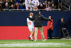 November 3, 2018 - Chicago, IL, U.S. - CHICAGO, IL - NOVEMBER 03: Shaun Davies (9) of USA is escorted off the field to seek medical attention after an injury in action during the Rugby Weekend match between the New Zealand Maori All Blacks and the USA Eagles on November 3, 2018 at Soldier Field, in Chicago, Illinois.  (Photo by Robin Alam/Icon Sportswire) (Credit Image: © Robin Alam/Icon SMI via ZUMA Press)